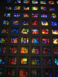 The stained glass windows were beautiful from inside the dark church.