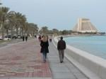 June and Jason walk along the Corniche.